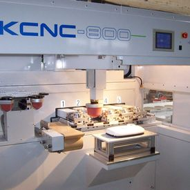 AKI makes its mark in CNC pad printing -