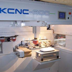 AKI makes its mark in CNC pad printing -