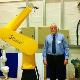 Staubli 6 Axis Robot Joins AKI Team - Managing Director, Allen Green with RX130 Robot